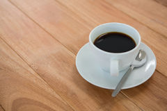 Black coffee served in white cup Royalty Free Stock Photography