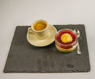 Black coffee in small porcelain cup with a sweet strawberry dess Stock Images