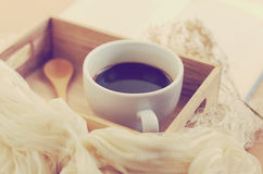 Black coffee and spoon on wooden tray, retro filter Royalty Free Stock Images