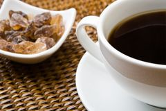 Black coffee and sugar Stock Photography