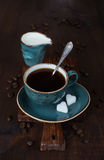 Black coffee with sugar Stock Images