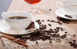 Black coffee with sugar chocolate and cinnamon Stock Photos