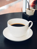 Black coffee with sugar in a cup Stock Images