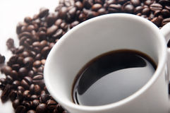 Black coffee on table withe coffee beans Stock Photography