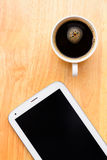 Black coffee and tablet Stock Image