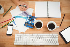 Black coffee and technologies with documents on table Royalty Free Stock Image