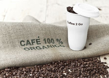 Black coffee to go on jute background Royalty Free Stock Photo