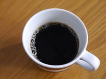 Black coffee, top view. A cup of coffee is on the table , view from top, bubble in the cup , coffee smell Stock Photos