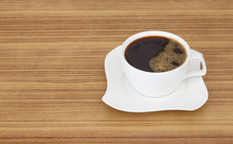Black coffee top view on wooden desk. Coffee cup top view on the desk wooden Stock Photo