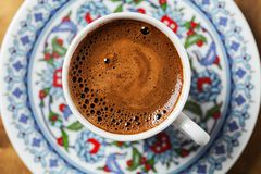 Black coffee in traditional Turkish cup stock photo