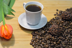 Black coffee, truffel sweets on coffee beans Stock Photography