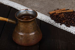 Black coffee. In turk with cinnamon and star anise Stock Photo