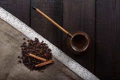 Black coffee. In turk with cinnamon and star anise Royalty Free Stock Images