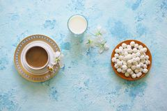 Black coffee, Turkish sweets and a glass of milk on a turquoise background. Ramadan food. Black coffee, Turkish sweets and a glass of milk on a turquoise stock photography