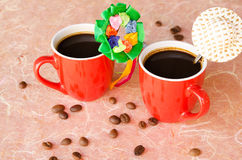 Black coffee in two red cups Stock Image