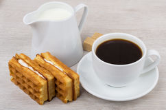 Black coffee with viennese waffles and jug milk on table Stock Images