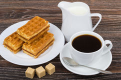 Black coffee with viennese waffles, sugar and jug milk. On wooden table Royalty Free Stock Photography