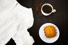 Black coffee in a white Cup, white shirt with an openwork collar on a dark background. Black coffee in white casne, white shirt with lace collar on a dark royalty free stock images