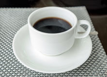 Black coffee in white ceramic cup Stock Photo