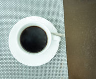 Black coffee in white ceramic cup. On table,top view Stock Image