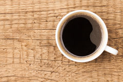 Black coffee in white ceramic cup on wooden table Royalty Free Stock Photos