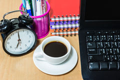 Black coffee in white cup and alarm clock Royalty Free Stock Images