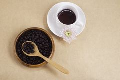 Black coffee in white cup and coffee beans. Top view Royalty Free Stock Image