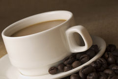 Coffee cup and saucer and Coffee beans  Royalty Free Stock Image