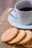 Black coffee in white cup and Crispy Rice Crackers with on woode. N table background. Select focus Royalty Free Stock Image