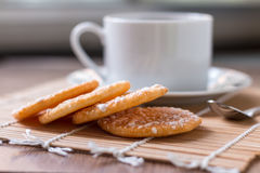 Black coffee in white cup and Crispy Rice Crackers with on woode Stock Image
