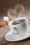Black coffee in white cup with heart shape steam royalty free stock photos