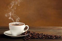 Black coffee in white cup with smoke Stock Photo