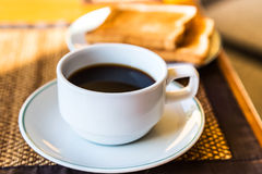Black coffee in white cup and toasts Royalty Free Stock Image