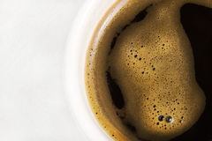 Black coffee in a white cup on a white background Stock Photography