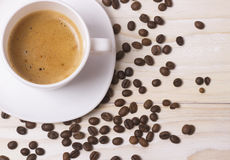 Black coffee in white cup on white wood table Royalty Free Stock Photos