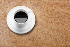Black coffee in white cup on wood table. For freshness Stock Images