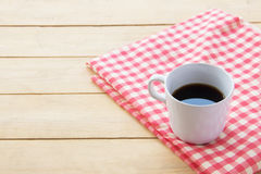Black coffee in white cup on wooden of brown,high angle view. Black coffee in white cup on wooden of brown Royalty Free Stock Photos