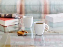 Black coffee in white mug glass topped table Royalty Free Stock Images