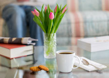 Black coffee in white mug glass topped table Stock Image