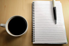 Black coffee and white notebook Royalty Free Stock Image