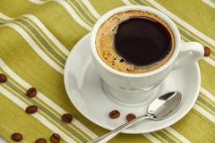 Black coffee in white porcelain cup Royalty Free Stock Photo