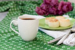 Black coffee in a white sophisticated cup, delicious dietary cheesecakes from home-made farmer cheese for breakfast,. A bouquet of stock photography
