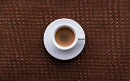 Black Coffee,White tableware. And colour fabric in natural sun light stock images