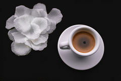 Black Coffee,White tableware. And colour fabric in natural sun light stock photography