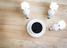 Black coffee on wood table.And brighten lamp. Royalty Free Stock Photography