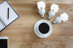 Black coffee on wood table.And brighten lamp. Stock Image