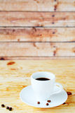 Black coffee on wooden background Royalty Free Stock Image
