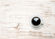 Black coffee on wooden table. Vintage style still life Stock Photos