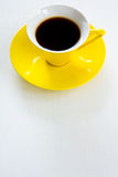 Black coffee in yellow cup and saucer Royalty Free Stock Photo