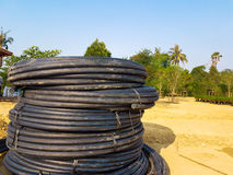 Black coil rubber hose put in the garden. Black coil rubber hose put on the sand in the garden view royalty free stock photography